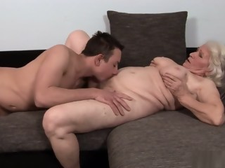 Big saggy tit granny gets a youngster to do the dirty with her   xxxvideo