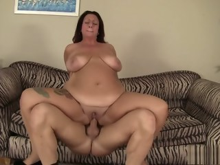 Chunky brunette mom with huge tits has a fiery cunt longing for action  brunette xxxvideo
