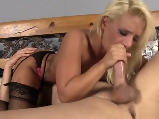 Blonde bombshell in black lingerie Cali Carter chokes on a long stick   xxxvideo