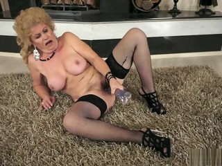Lustful granny in black stockings uses a glass dildo to find pleasure granny stockings xxxvideo