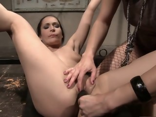 Naughty brunette gets her tight cunt worked by a wild dominatrix   xxxvideo