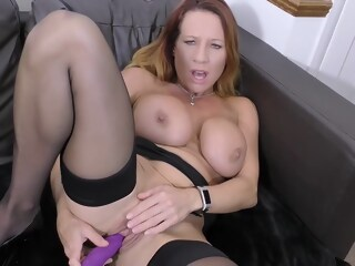 Busty blonde woman is playing with her big tits while getting ready to rub her pussy woman blonde xxxvideo