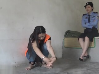 Chinese Prison Girl in Inescapable Metal Bondage girl prison xxxvideo